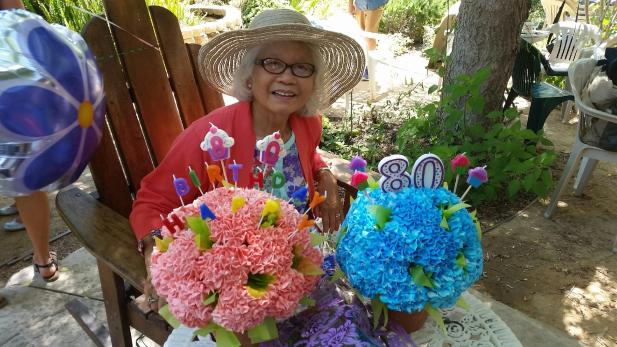 My beautiful Mom smiling with her cupcake bouquets--YES real cupcakes made to look like hydrangea flowers in terra cotta flower pots! My friend Chanda has just inspired me to start learning how to make them.  (She made these ones for my mom.  Thanks Chanda! XOXO!)