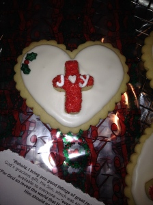 "A Christmas ""JOY"" Cookie Heart ready to be wrapped and tied with curling ribbon!"